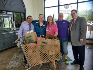 Wister teachers Amy Wisdom and Donna Deaton pictured with Galleria Furniture Employees and the school supplies donated by The GTO Foundation