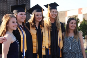 CASC graduates pose together with friends.