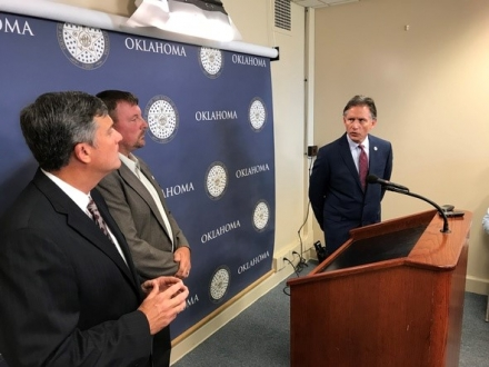 Attorney General Mike Hunter (right) discusses the rate decrease and what it means for OG&E customers with Public Utility Director for the Oklahoma Corporation Commission Brandy Wreath (center) and AARP State Director Sean Voskuhl.