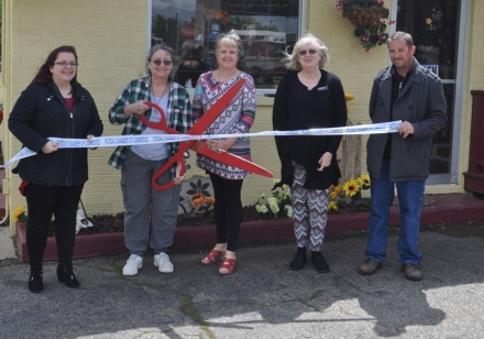 Pictured in the Ribbon Cutting are Sara Powell, Poteau Chamber, Dani Montoya, Karen Wages, Poteau Chamber, Sandy Ellis, Print by Design and Eric Standridge, Historic Downtown Poteau Director.