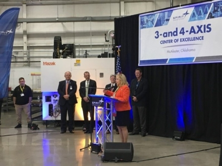 Governor Mary Fallin congratulates Spirit AeroSystems officials during Wednesday's opening of the aerospace company's center of excellence in McAlester. The center focuses on the fabrication of complex commercial and military aircraft parts.