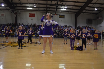Kendal Stinson (front) and Tristin Hagelberger (back) help the Wister Little Cheerleading squad during their performance