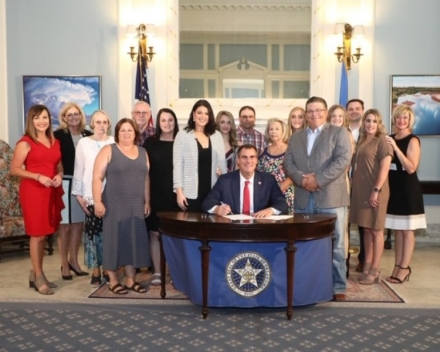 Rep. Scott Fetgatter, Sen. Kim David, victims, victims' rights advocates and friends and family members gather with Gov. Kevin Stitt in the Blue Room at the Oklahoma State Capitol for a ceremonial signing of House Bill 1881, Kaylee's Law.